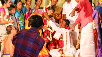 The exchanging of garlands signifies the marriage.